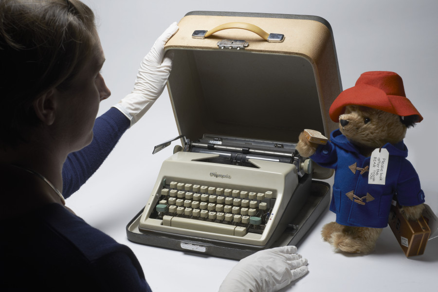 Museum of London curator, Hilary Young, with the original typewriter (1965) that Michael Bond used to write 'Paddington at Work' and 'Paddington Goes to Town' once he left the BBC in 1965 to write Paddington full-time. As Paddington makes his big-screen debut this November, the Museum of London is celebrating the small stowaway from Darkest Peru and his London adventures with a new exhibition, A Bear Called Paddington, opening on 14 November 2014.
